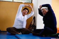 People stretching while in a lotus position