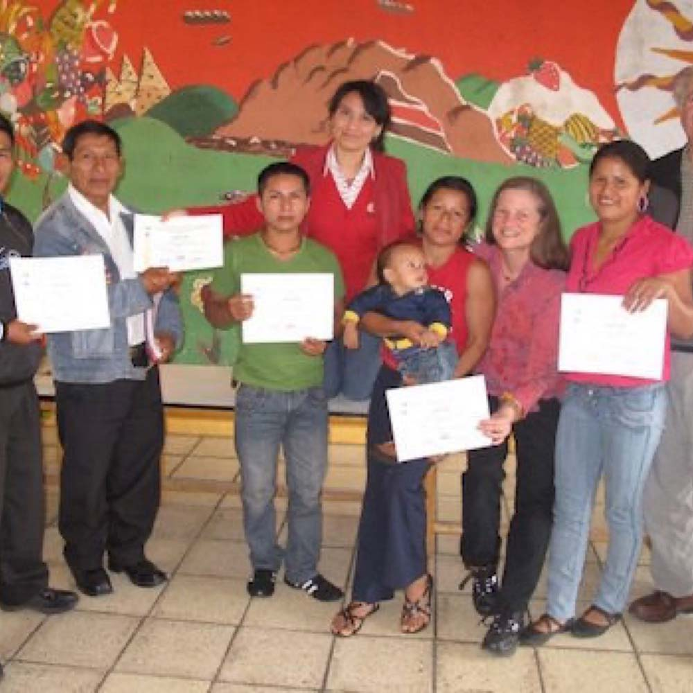 Janet and students with certificates