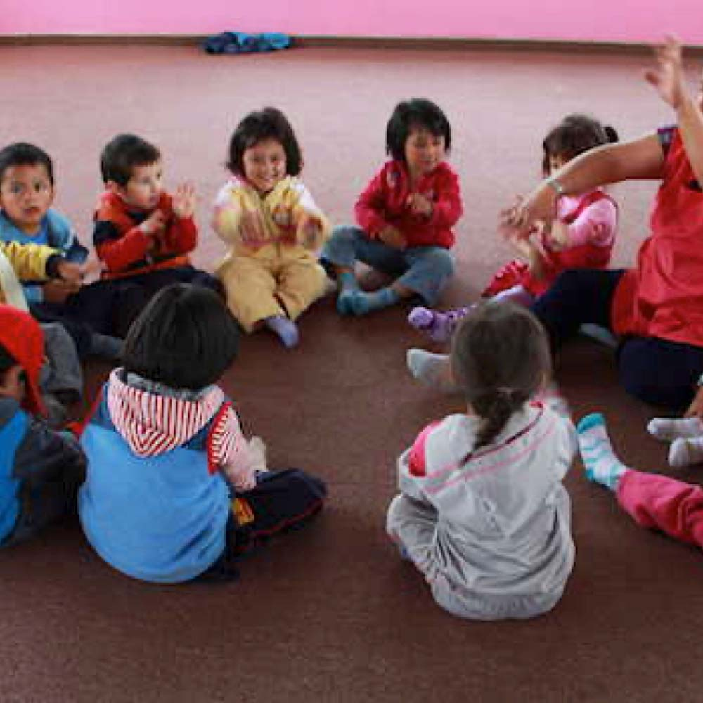 Small children sitting in a circle